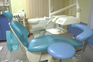 Modern dentist's chair in a medical room.